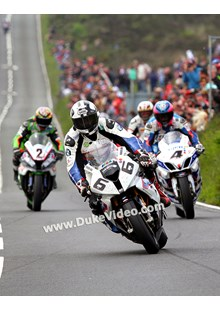 Michael Dunlop leads the pack in to Creg-ny-Baa